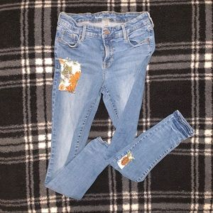 "Old Navy ""Rockstar"" mid-rise jeans w/ patches"
